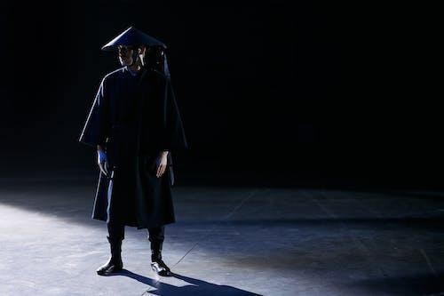 Woman in Black Academic Dress Standing on White Floor