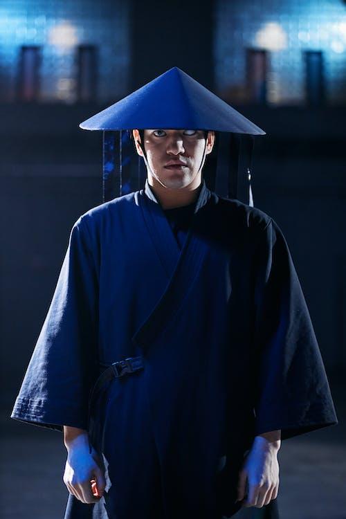 Man in Blue Academic Robe
