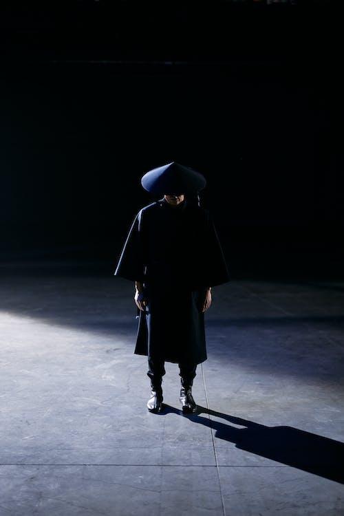 Woman in Black Coat Walking on Gray Concrete Floor