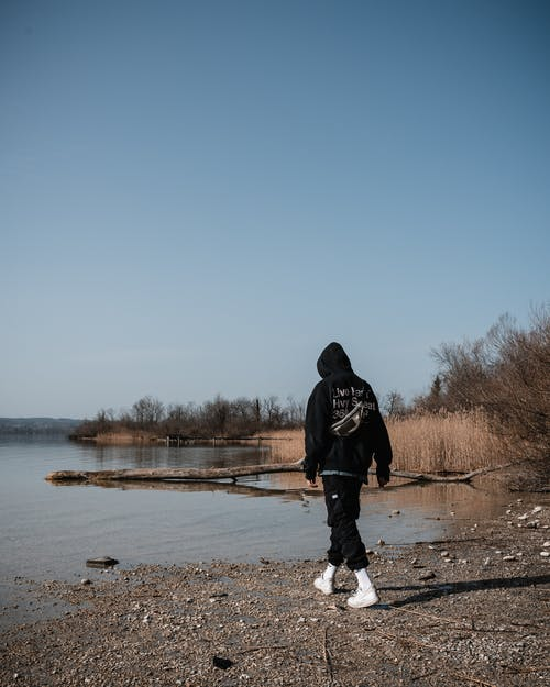 Free stock photo of a person, beach, blue lake
