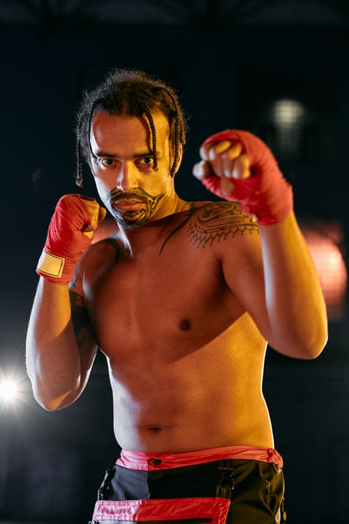 Topless Man Wearing Red Boxing Gloves