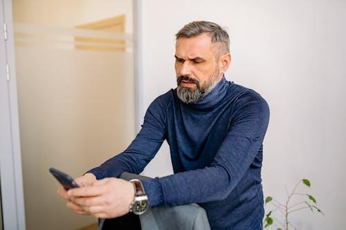A Man Using His Cellphone