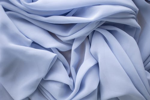 Close-Up Shot of a Wrinkled Light Blue Fabric