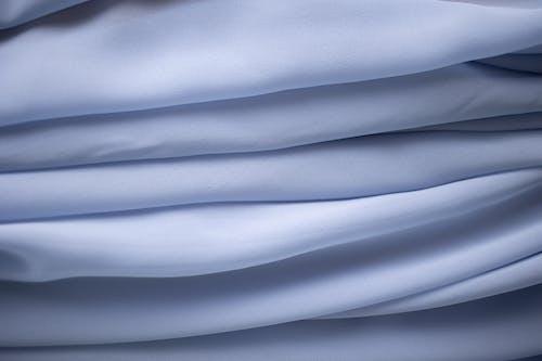 Close-Up Shot of a Light Blue Fabric