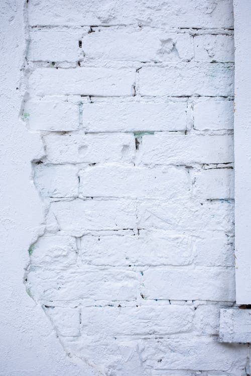 Green Brick Wall With White Paint