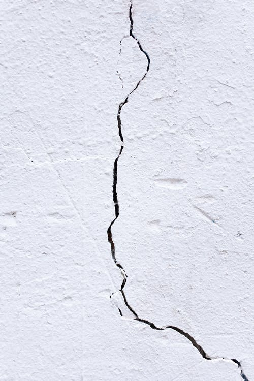 Black and White Coated Wires on White Concrete Wall
