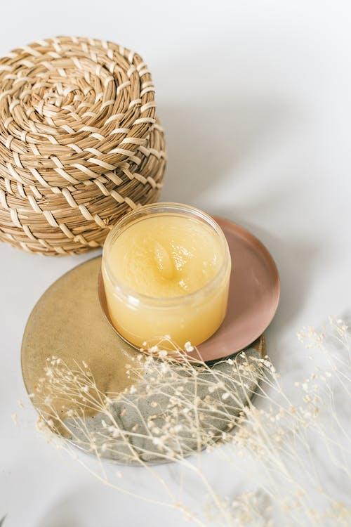 Yellow Cream on a Clear Jar
