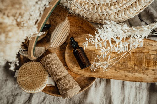 Cosmetic Brown Glass Bottle on Wooden Tray