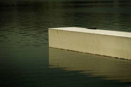 Brown Concrete Wall on Water