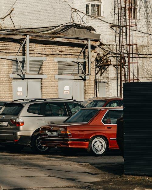 Red Suv Parked Beside Black Steel Gate