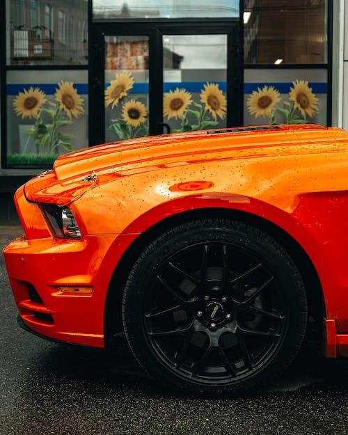Orange Car Parked Near Building