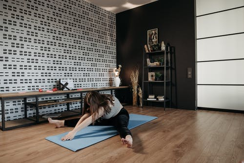 Woman Doing Stretching on the Floor