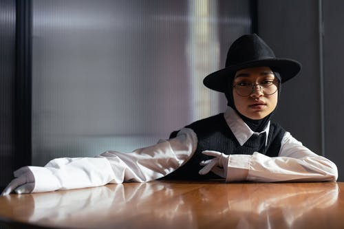 Woman in Black Hat and White Dress Shirt