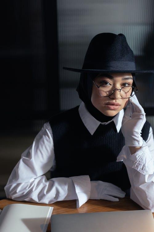 Woman Wearing a Black Hat and White Dress Shirt