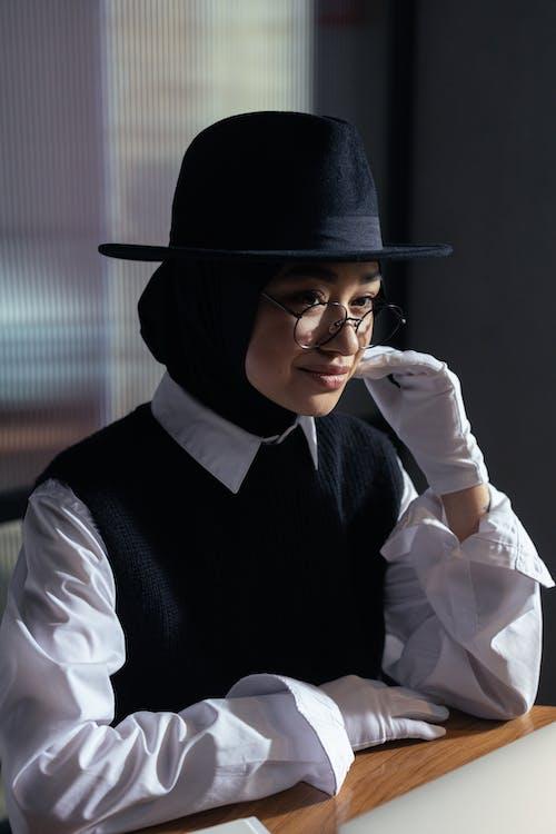 Woman Wearing a Fedora Hat