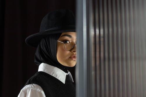Woman Wearing Black Hijab and Hat