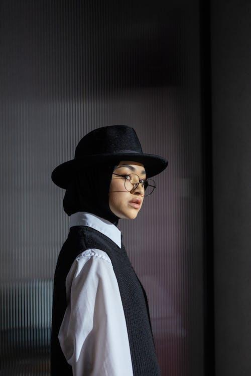 Woman Wearing Black Fedora Hat
