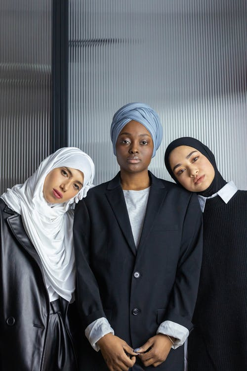 Women Wearing Hijab Leaning on Another Woman's Shoulders