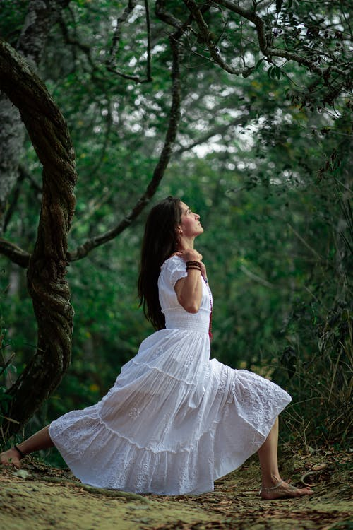 Woman in White Dress Sitting on Tree