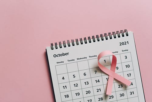 White and Black Calendar on Pink Wall
