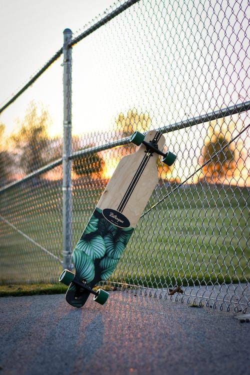 Man in Green Jacket and Black Pants Playing Baseball