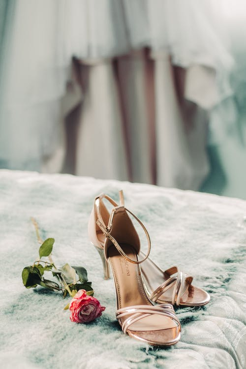 Brown Leather Open Toe Sandals on White Textile