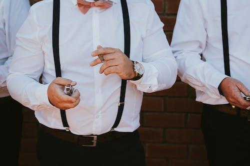 Man in White Dress Shirt and Black Pants Wearing Black Necktie