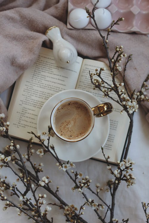 A Cup of Coffee on a Book