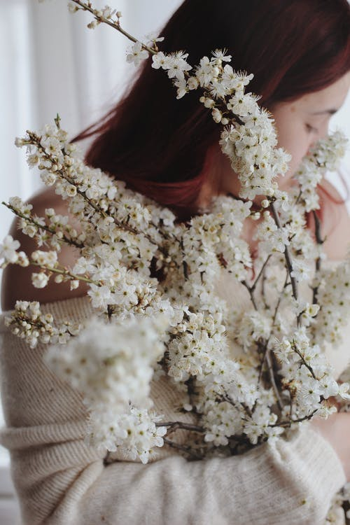 Woman Holding White Flowers