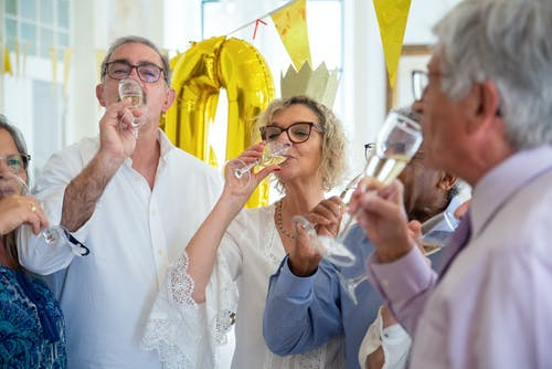 Elderly {People Drinking Champagne Together