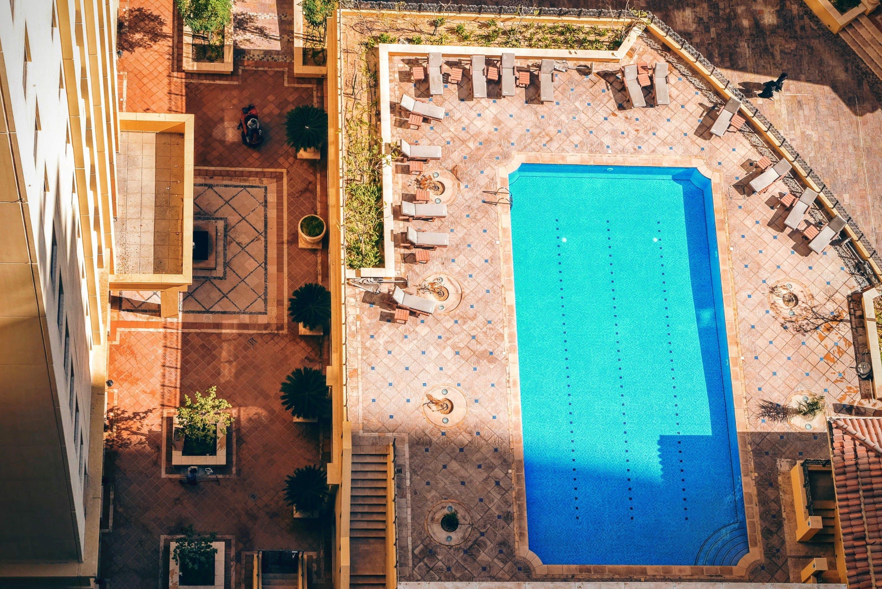 Rectangular Pool Near High Rise Building during Daytime