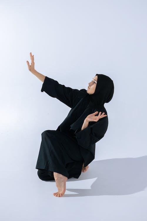 Woman in Black Hijab and Abaya