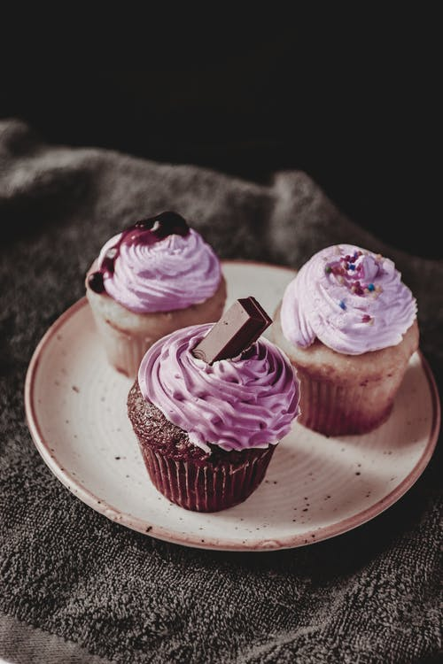 Sweet cupcakes with cream on plate