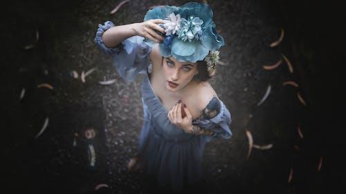 Woman in Blue Dress with Blue Flower Headdress