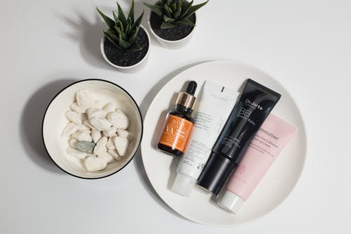 Skincare Products on White Round Plate