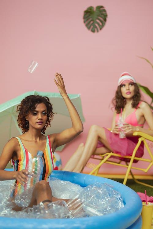 Women Having Fun at the Indoor Swimming Pool Set-up