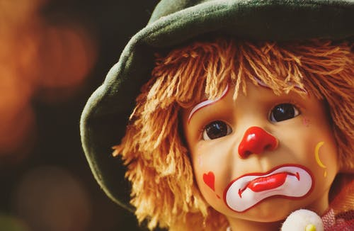 Brown Haired Doll With Red and White Heart on Head