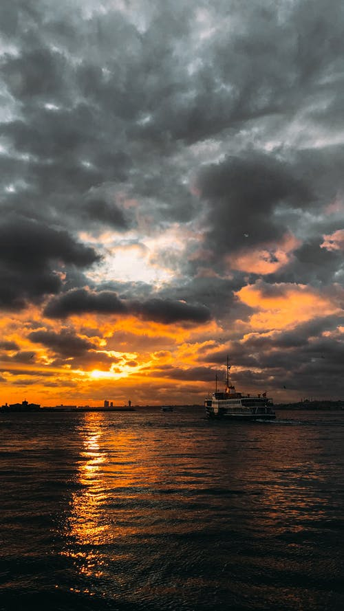 Ship sailing at sunset time