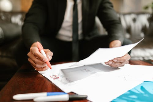 Man Working With Documents On Table
