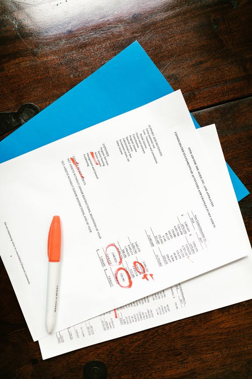 Financial Documents On Wooden Surface