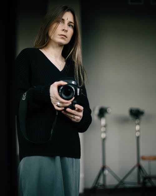 Young woman with photo camera