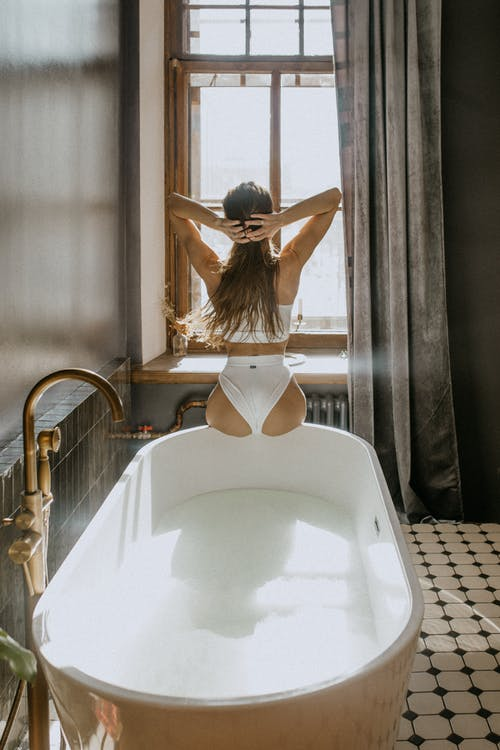 Woman in White Brassiere and Panty on Bathtub