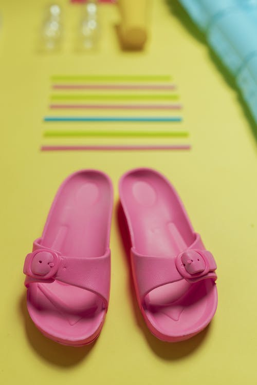 Pink Slide Sandals on Yellow Surface