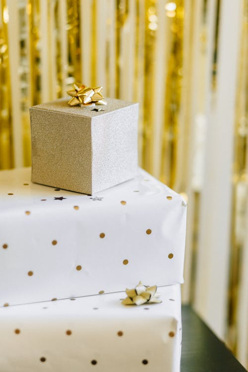 Gold and Silver Gift Box on White Table