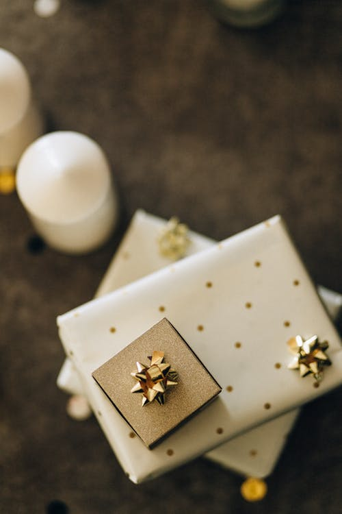 Gold and Black Accessory on White Box