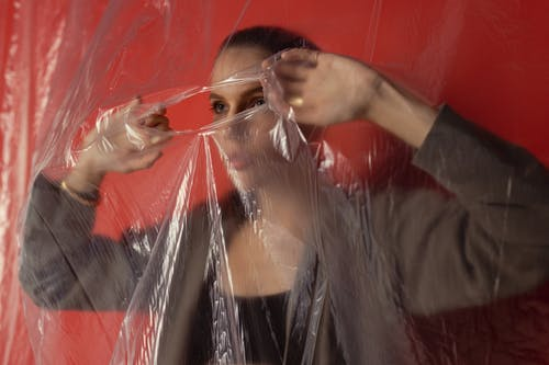 Woman Tear the Plastic to Go Out