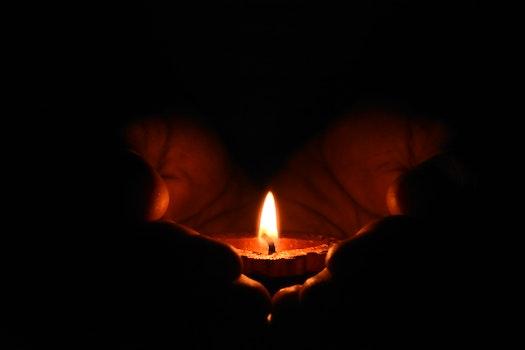 Tealight Candle on Human Palms