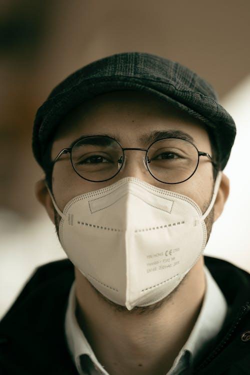 Man in medical mask and eyeglasses