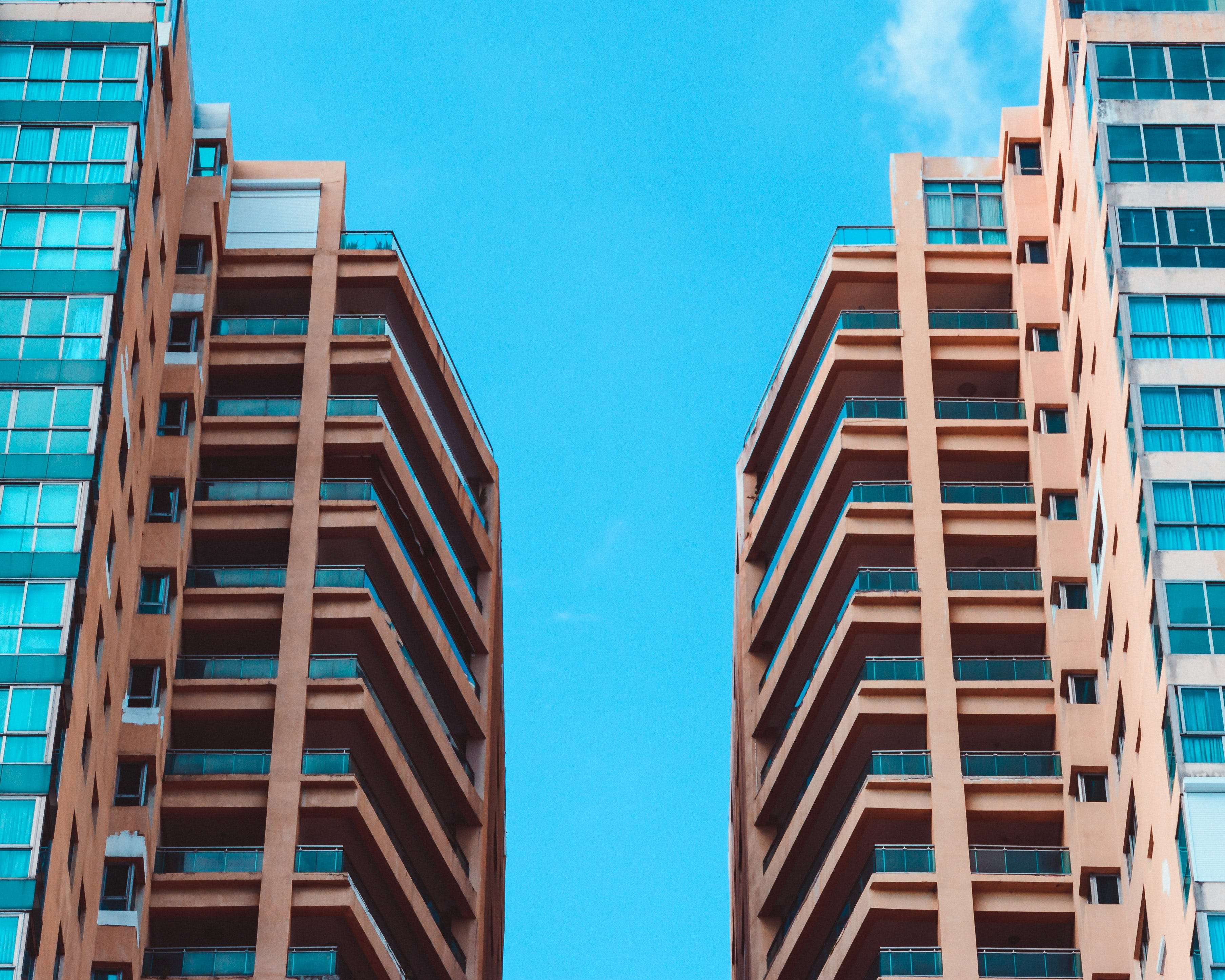 Low Angle View of Two High Rise Buildings Under Blue Sky