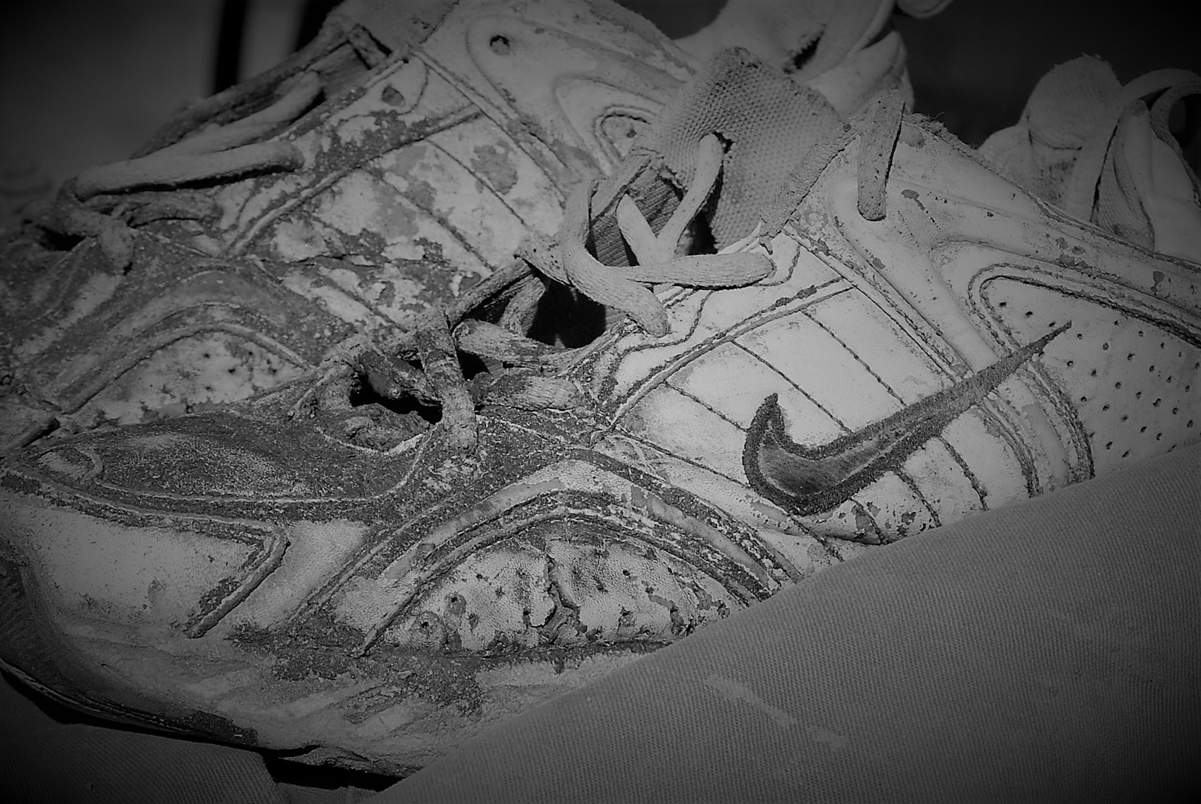 Free stock photo of Old Shoes Black White Worn Nike Running Shoes